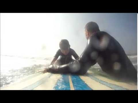 Oliver's first surf on Dad's longboard.