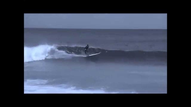 Crocket surfing maldives longboard style