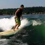 Longboard wakesurfing on Lake Sammamish 2011   9′ 6″ Becker pu single fin with side bites.